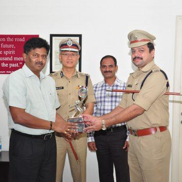 Sri G.V.G. Ashok Kumar, I.P.S, DCP, Admn, Vijayawada City receiving FICCI Smart Policing - 2017 award from Honourable DGP of A.P.  Sri N. Sambasiva Rao, IPS