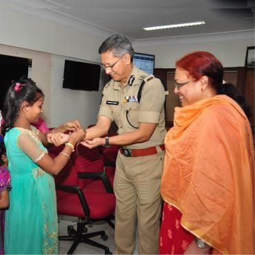 Children tie Rakshi on Sri D. Gautam Sawang, IPS, Commissioner of Police's wrist on the occassion of Raksha Bandhan on 07.08.2017
