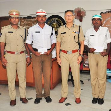 Sri D. Gautam Sawang, IPS, Commissioner of Police appreciating two traffic police personnel who rescued a woman, aged 60 years from drowning in Eluru Canal on 08.07.2017