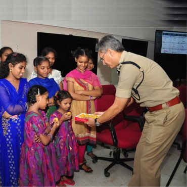 Sri D. Gautam Sawang, IPS, Commissioner of Police gives Sweets to Children on the occassion of Raksha Bandhan on 07.08.2017
