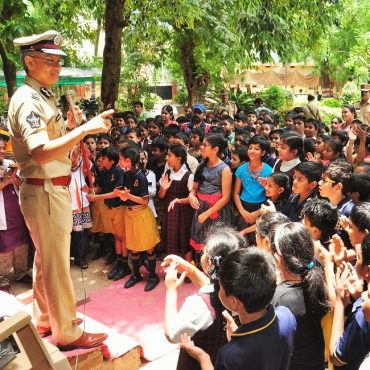 Sri D. Gautam Sawang, IPS, Commissioner of Police teaching about Police Services to School Children on 26.07.2017