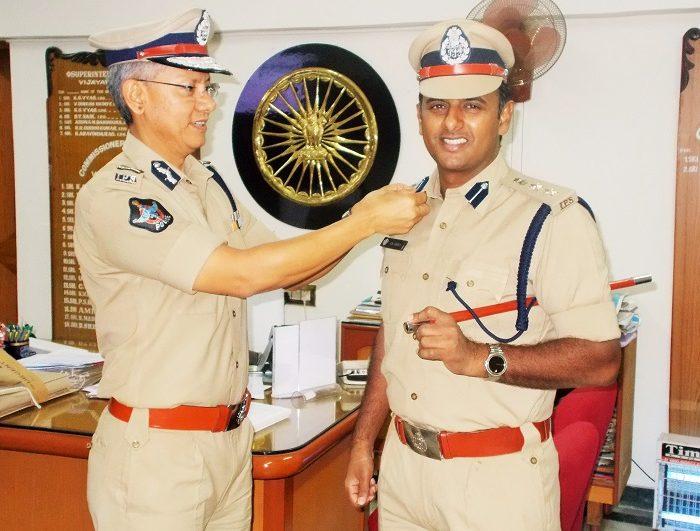 Sri D. Gautam Sawang, IPS, Commissioner of Police arranging collar tabs to Sri Kanthi Rana Tata, IPS for his promotion as Senior Supdt. of Police - 14.08.2017